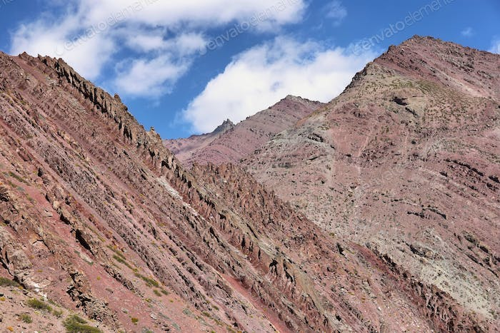 Colorful rugged mountains and river along Markha Valley trek, Ladakh, India.