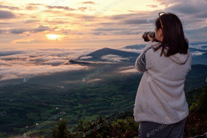 Women are shooting sunrise.