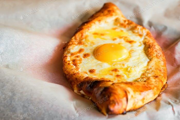 Ajarian khachapuri Georgian cheese pie with egg close
