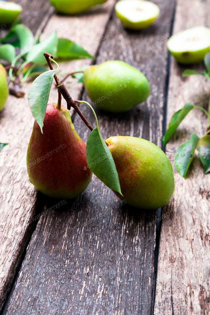 Pear on wooden rustic background. Autumn harvest.