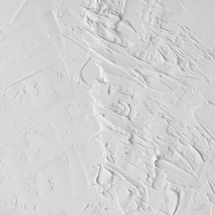 White abstract oil paint texture on canvas or wall.