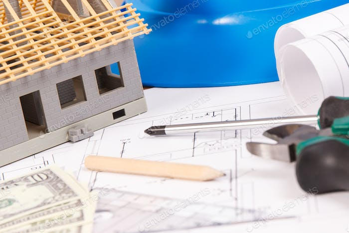 Electrical drawings, work tools and accessories, small house and currencies dollar