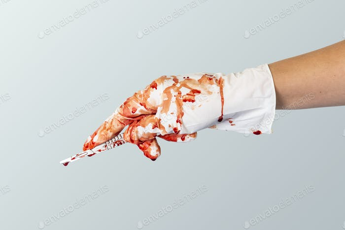Doctor bloody hand in a glove holding a scalpel mockup