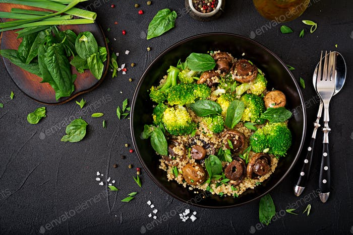 Healthy vegan salad of vegetables - broccoli, mushrooms, spinach and quinoa