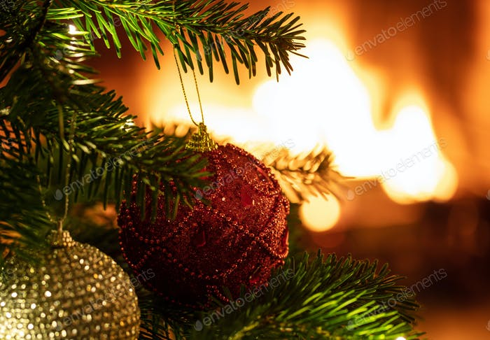 Christmas tree close up on blur fireplace background