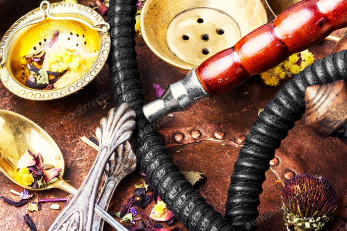 Oriental tobacco hookah with floral tea aroma