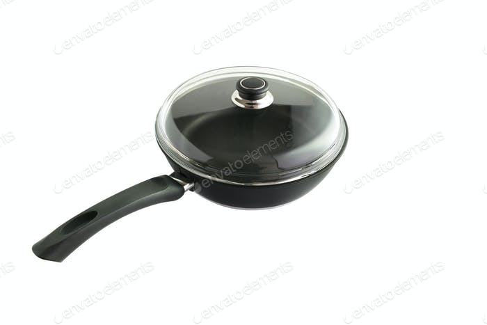 Saucepan covered by glass lid