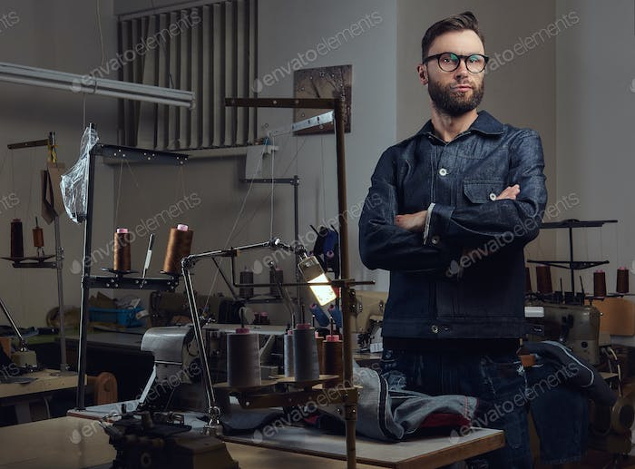Bearded fashion designer in a sewing workshop