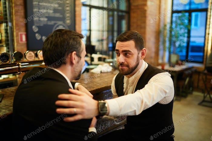 Two Businessmen Relaxing in Bar