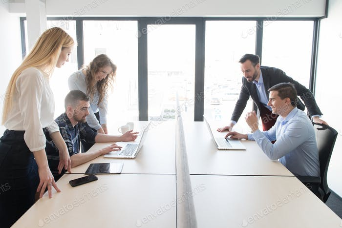 Group of colleagues working in contemporary office