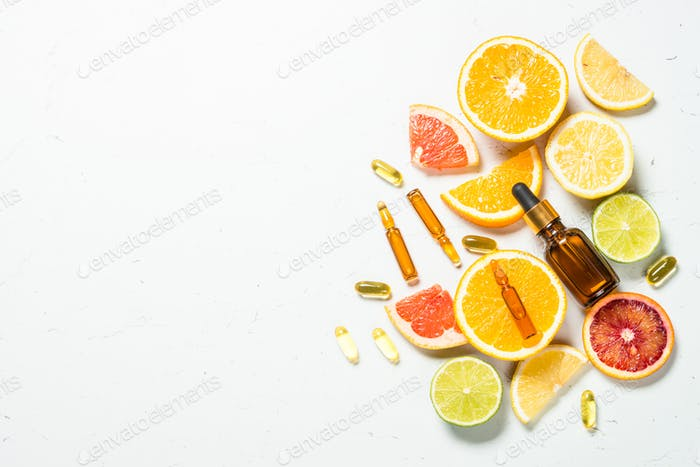 Vitamin C. Cosmetic products and fresh citrus fruits.