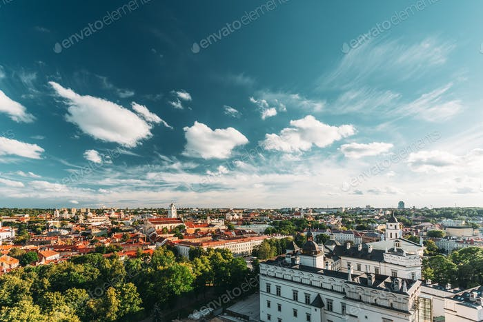 Vilnius, Lithuania. Old Town Historic Center Cityscape Under Dramatic Sky And Bright Sun In Sunny