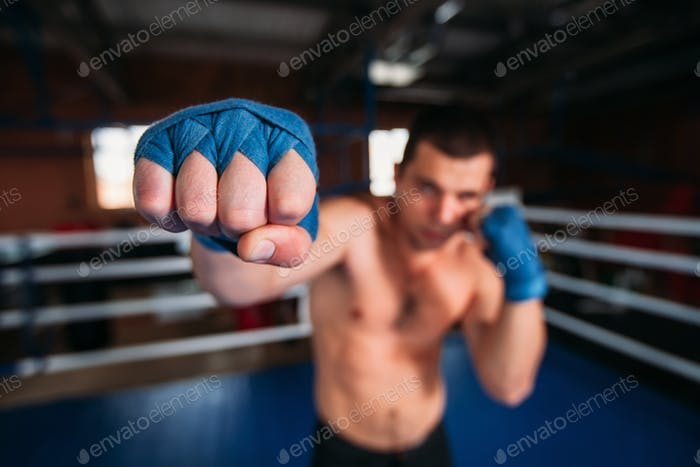 Boxer in blue wrist wraps on the training.