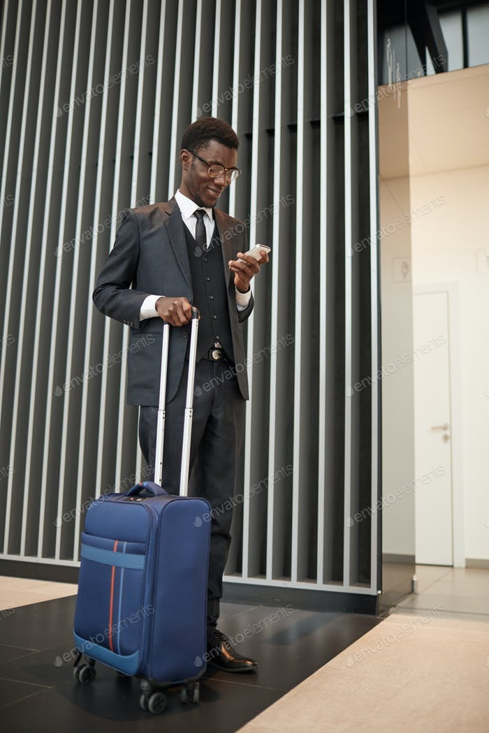 African man with luggage