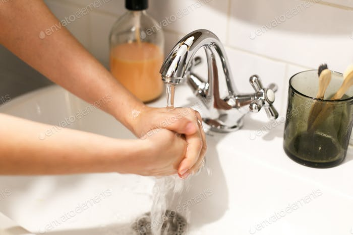 Hands washing with proper technique and antibacterial soap