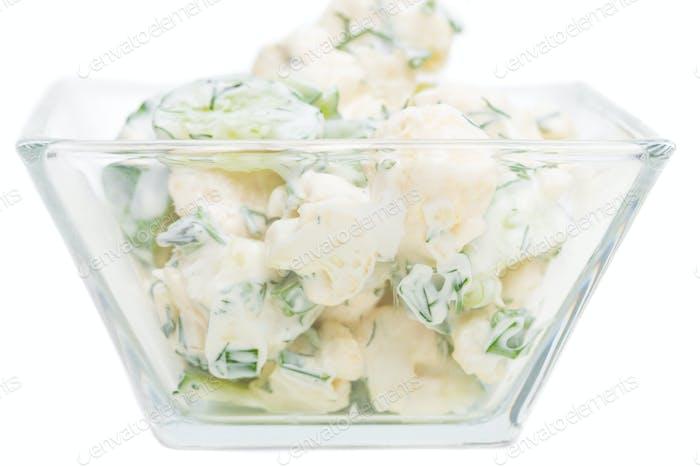 Cucumber and cauliflower salad with sour cream.