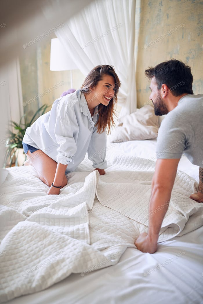 Couple  enjoying intimate moment at morning in bed.