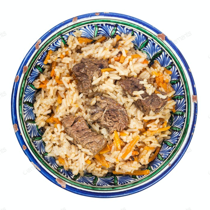 top view of plov in traditional ceramic bowl