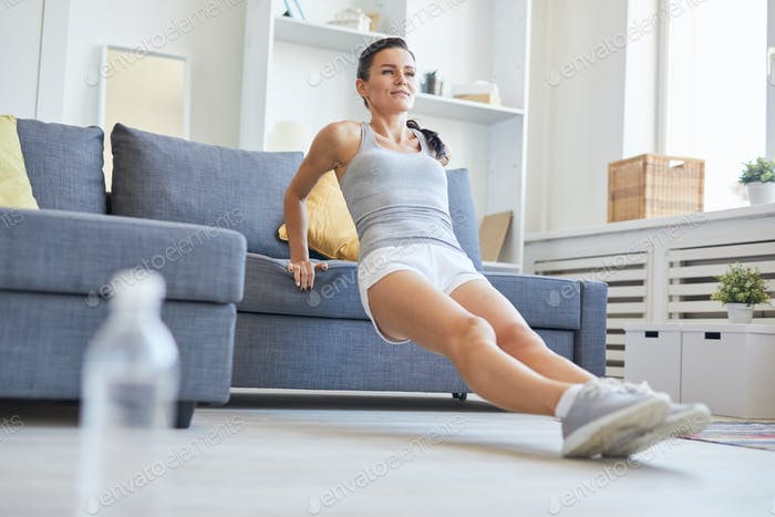 Exercising by sofa