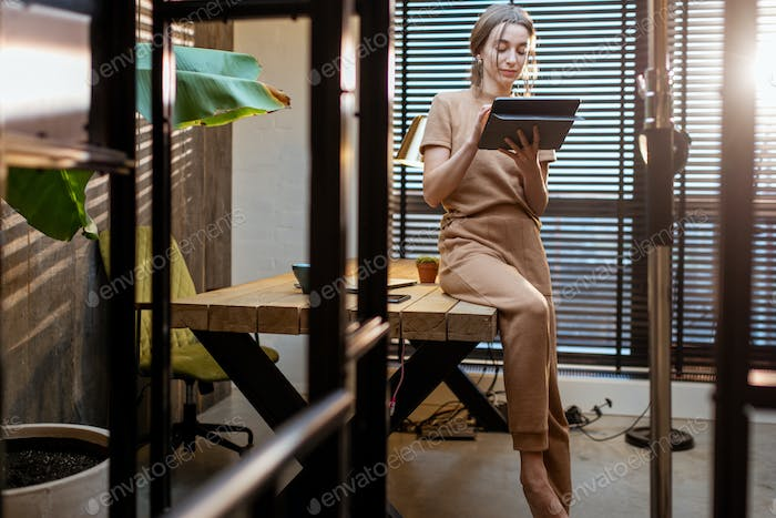 Creative woman with a digital tablet at home office