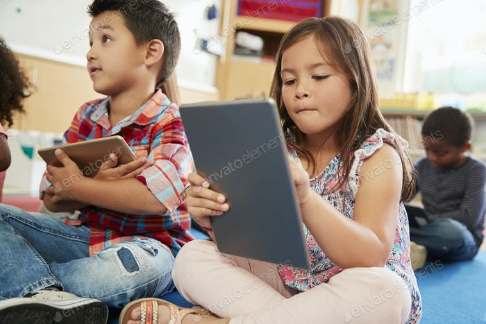 Elementary school class using tablet computers, close up