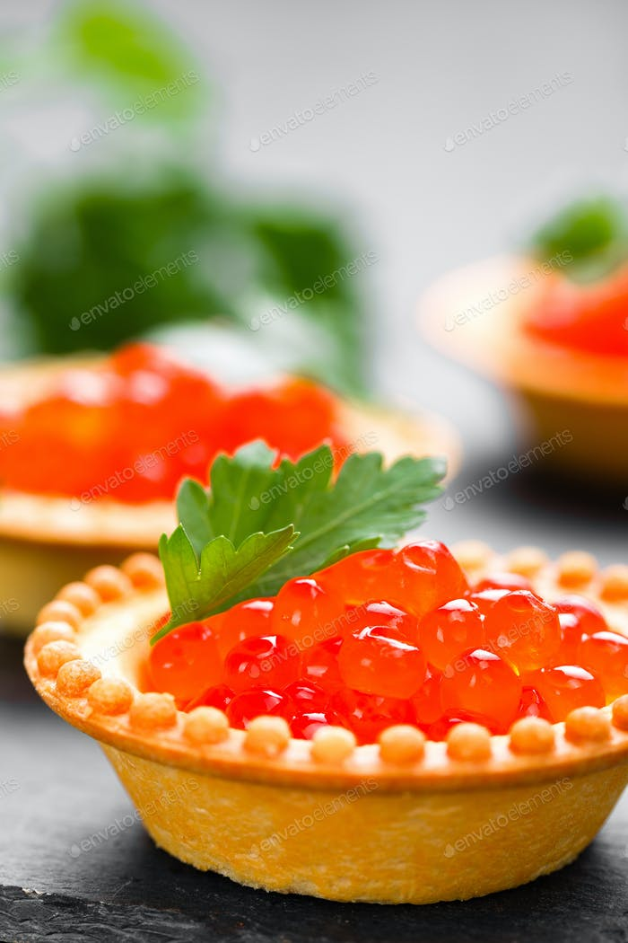 Tartalets with red salmon fish caviar, salmon caviar. Caviar. Selective focus