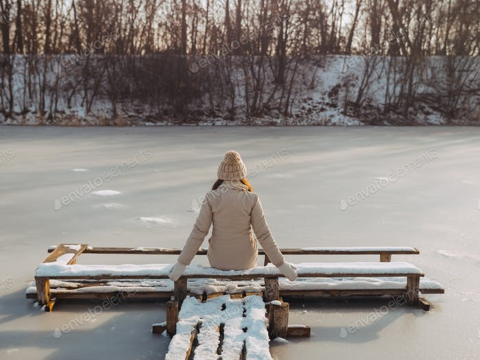 Winter Woman Resting Outdoors on Nature