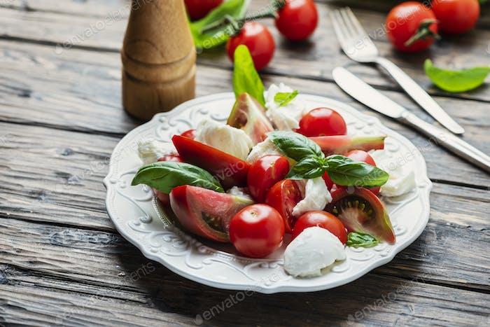Italia salad caprese with tomato, basil and mozzarella