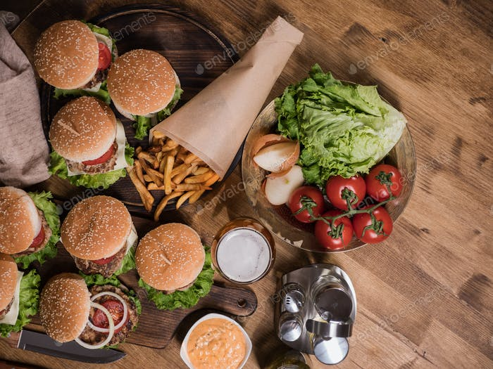 Top view of various fast food on a wooden table