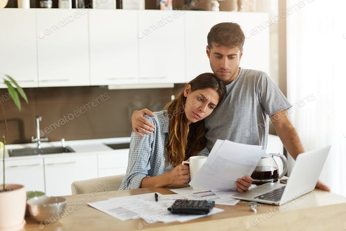 Negative human emotions. Financial problems. Portrait of unhappy young couple having looking worried