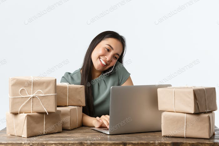 Small business owners, startup and e-commerce concept. Smiling friendly asian businesswoman with