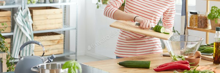 Cucumber falling into a bowl