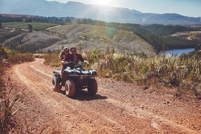 Young couple enjoying off road vehicle ride