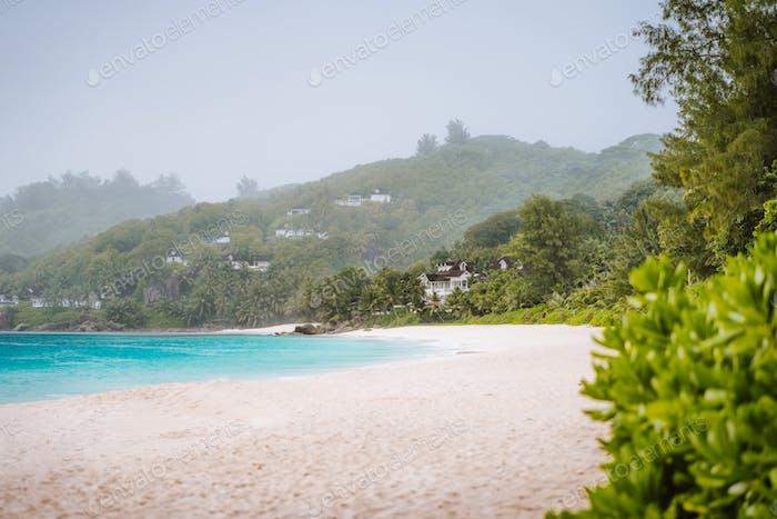 Tropical rain on anse intendance beach on Mahe island in Seychelles