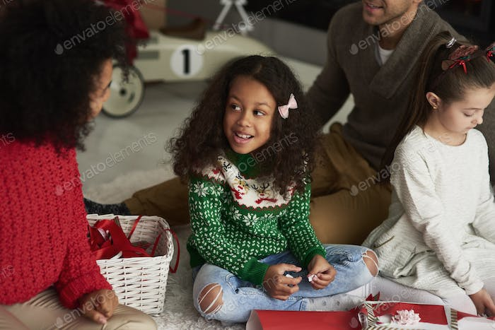 Happy family packing gifts for Christmas