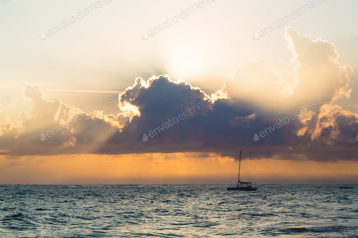 Sunrise over Atlantic ocean with yacht, Dominican Republic