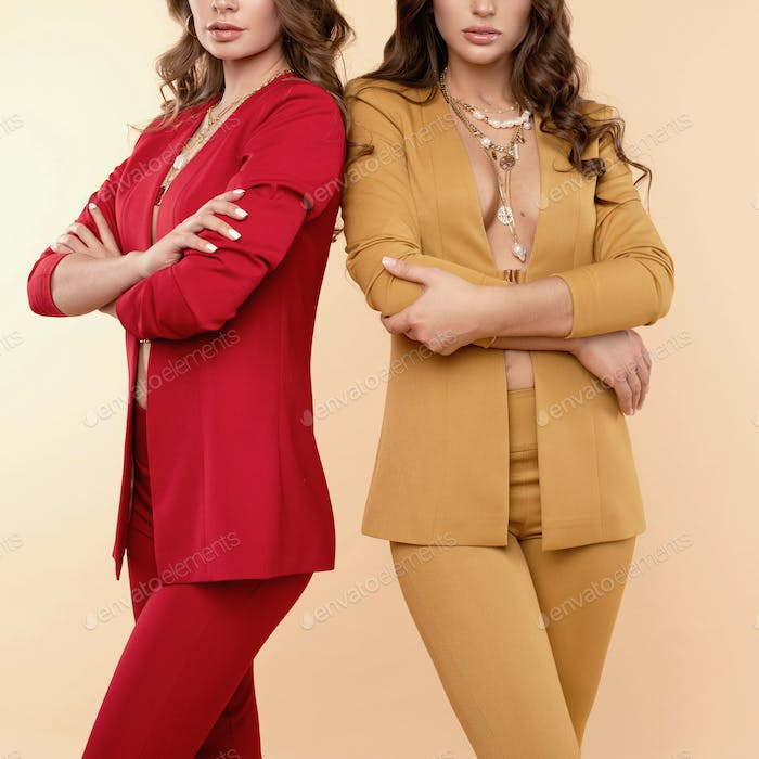 Two fashionable women in nice clothes. Fashion spring summer photo