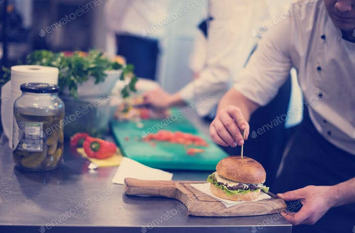 chef finishing burger