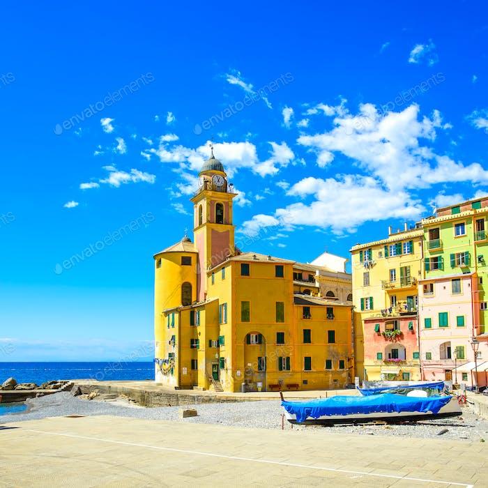 Camogli church on sea, boats and beach view. Liguria, Italy