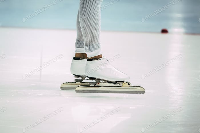 closeup feet girl speed skaters