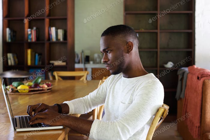 Young black man using laptop computer