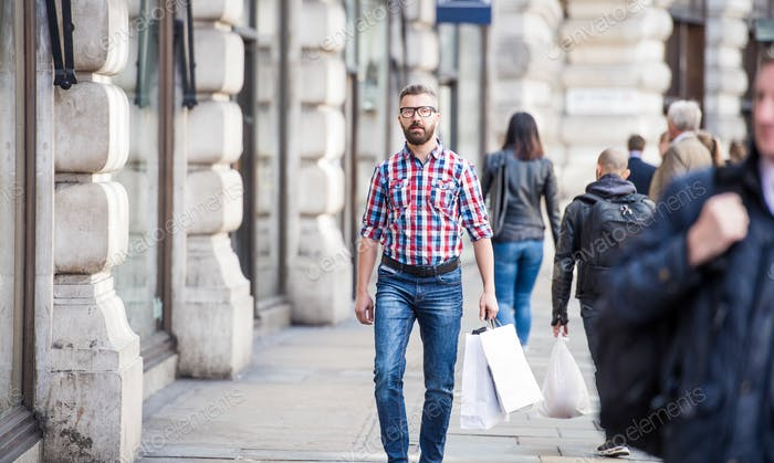 Young man shopping in the city