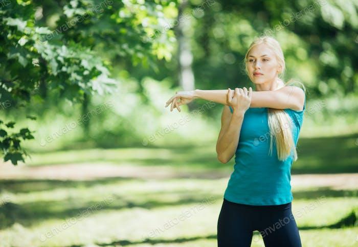 Sport. Woman nature portrait doing exercises. Healthy lifestyle