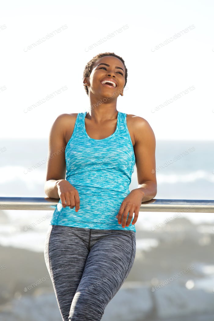 young fitness woman laughing outside