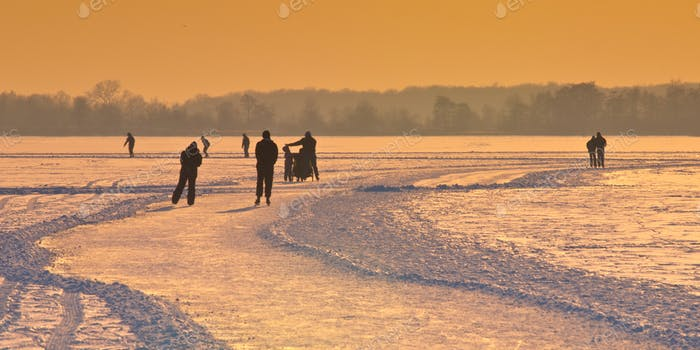 Dutch Ice Skaters under setting sun