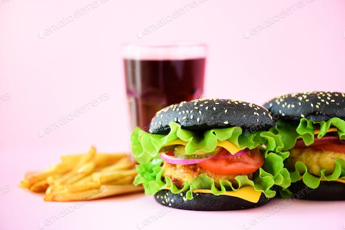 Fast food frame. Delicious meat burgers on pink background. Take away meal. Unhealthy diet concept