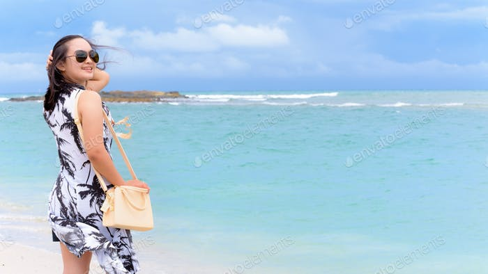 Woman tourist on the beach in Thailand