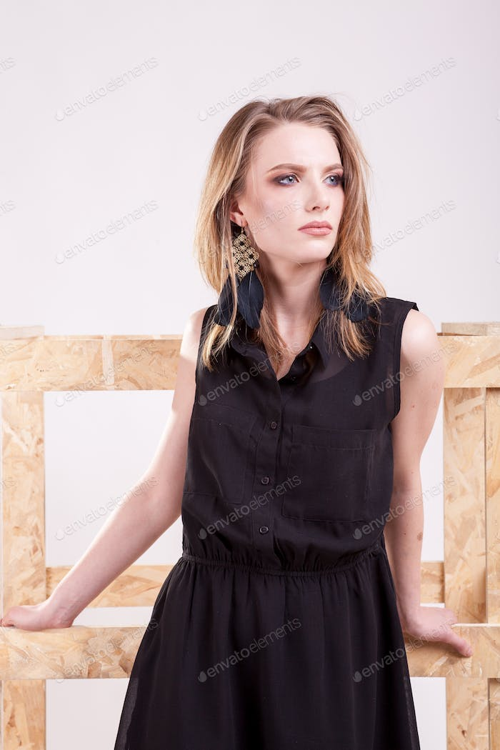 Gorgeous blonde model posing fashion in studio photo