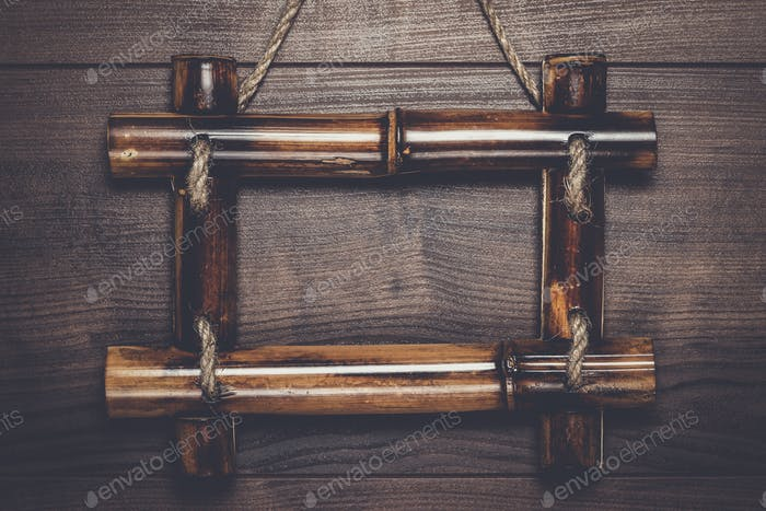 empty frame hanging on wooden wall