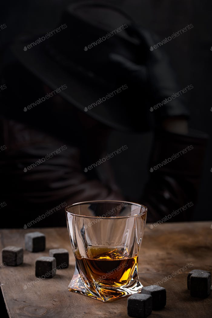 Glass of whiskey and stones
